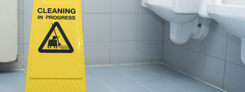 How often should workplace toilets be cleaned?